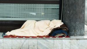 homeless woman in blanket