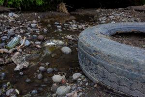 car tire in stream